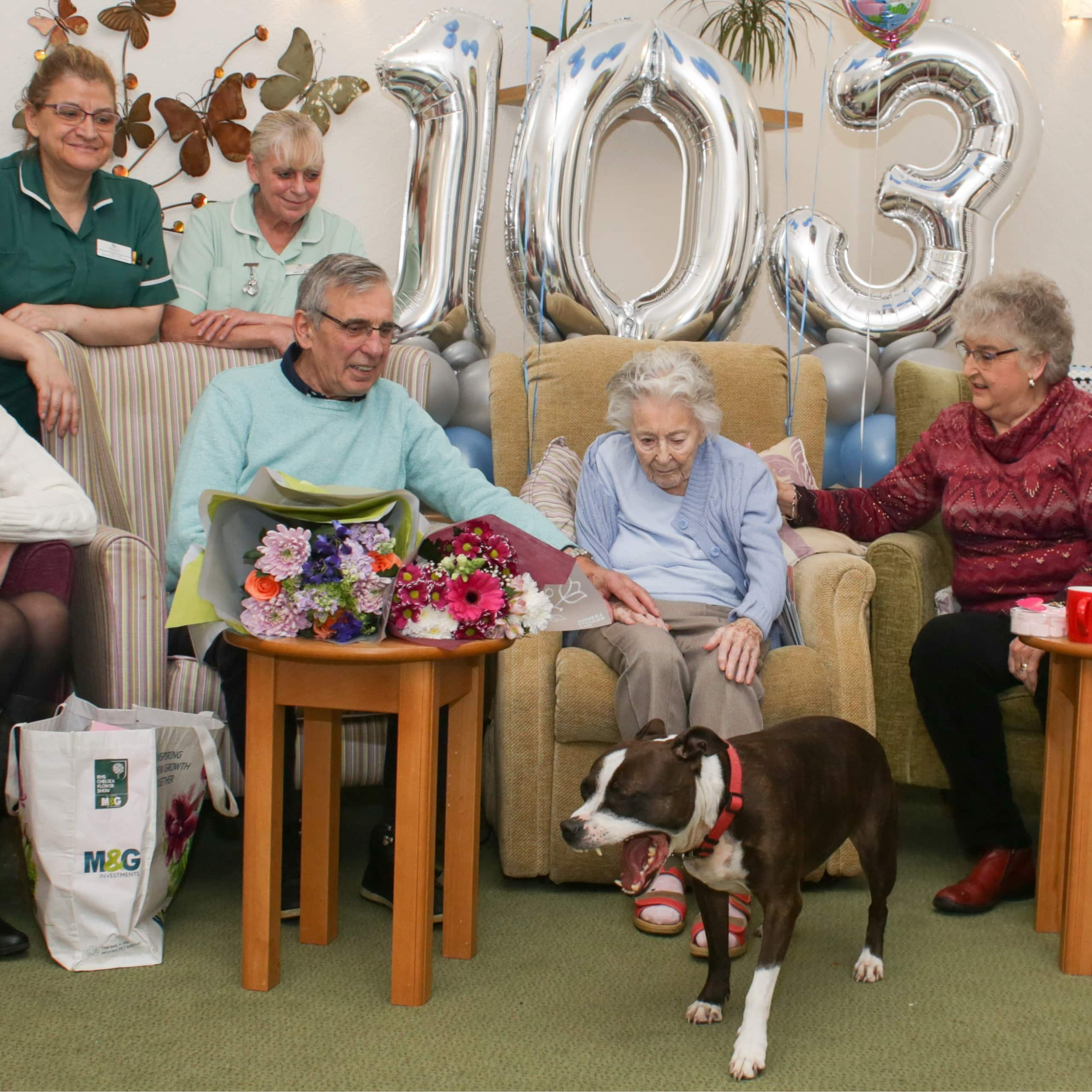 Westerham Place Care Home resident Mickie surrounded by friends and family celebrating her birthday.