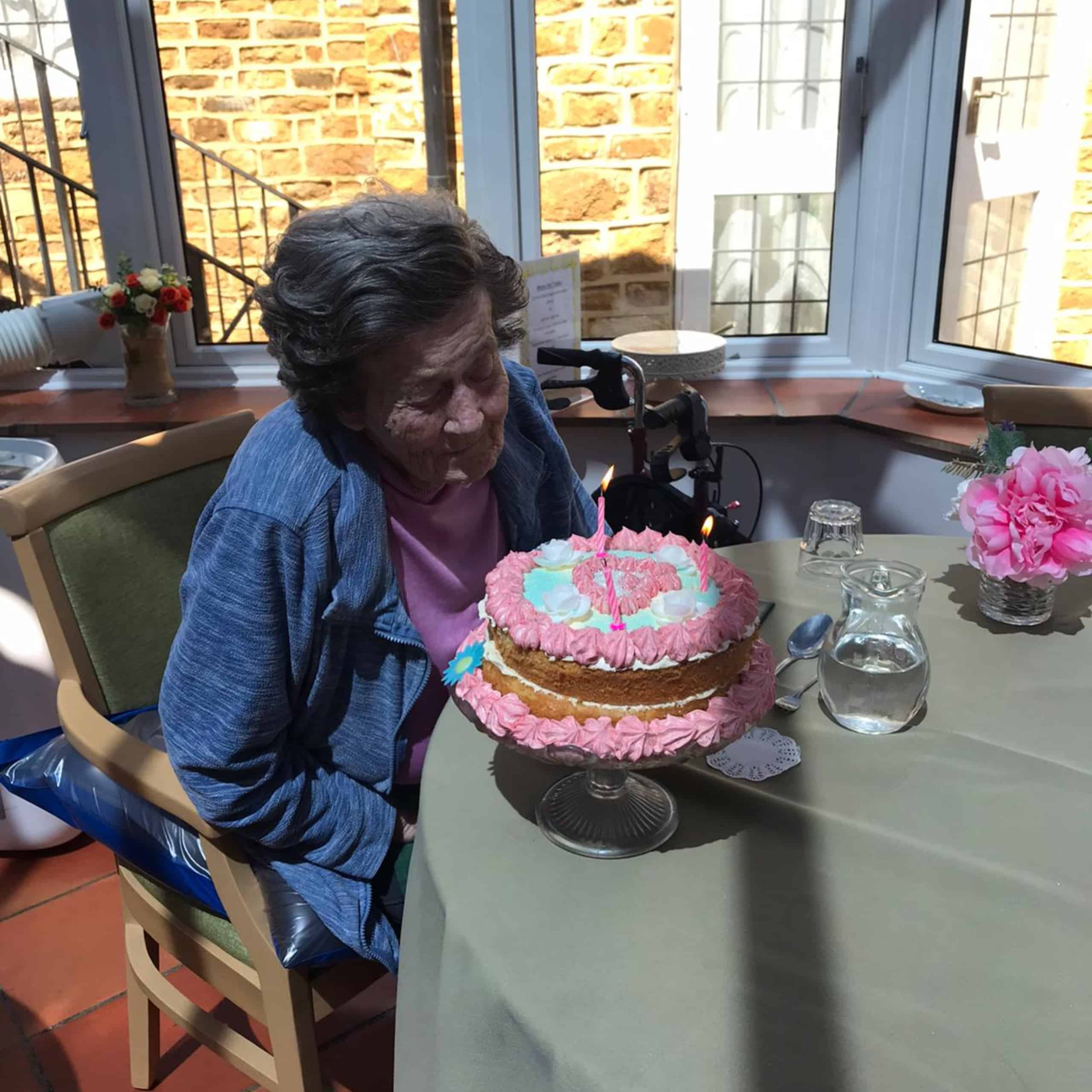 Featherton House Care Home resident Pamela with her home made birthday cake.