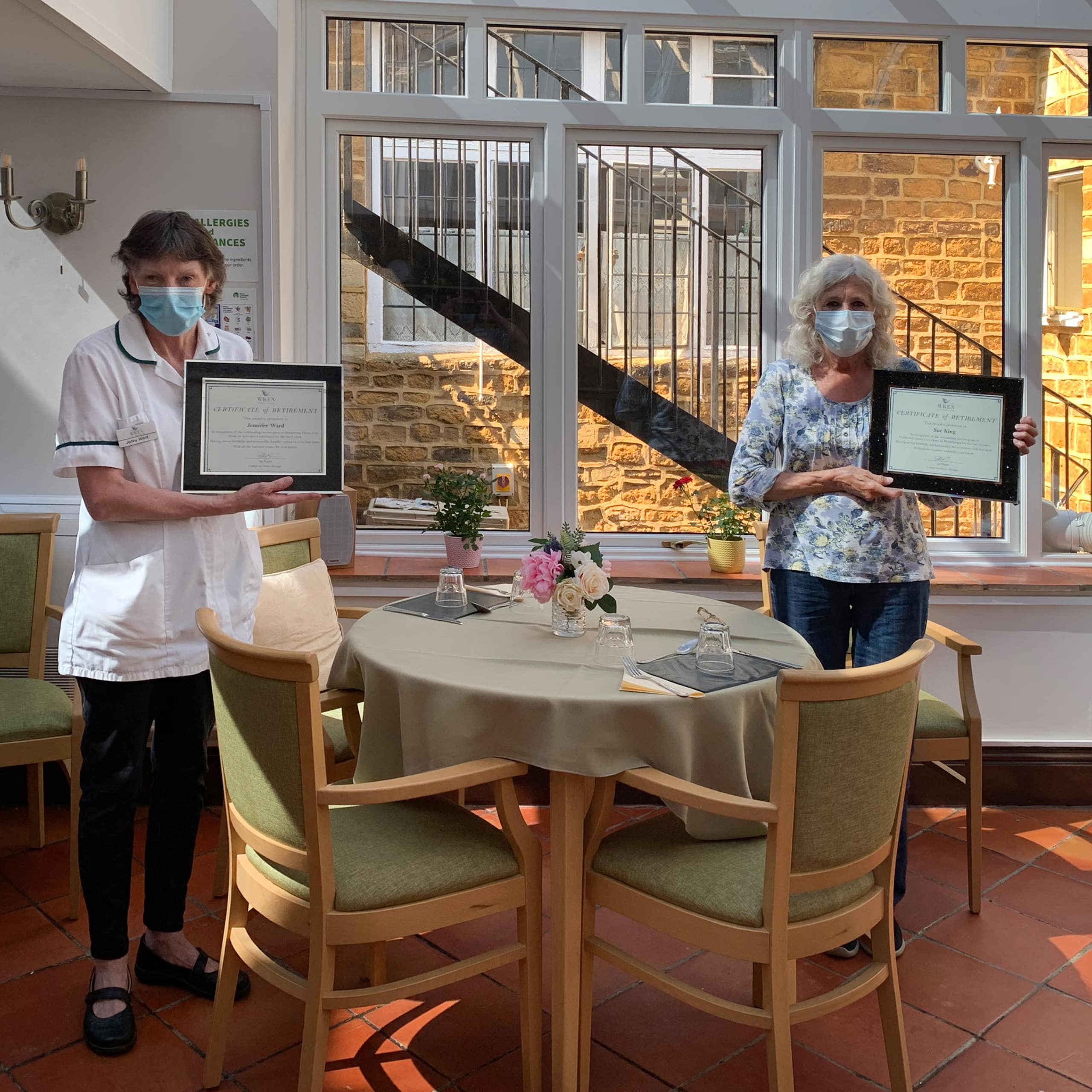 Featherton House Care Home employees Sue King and Jennifer Ward with their retirement certificates