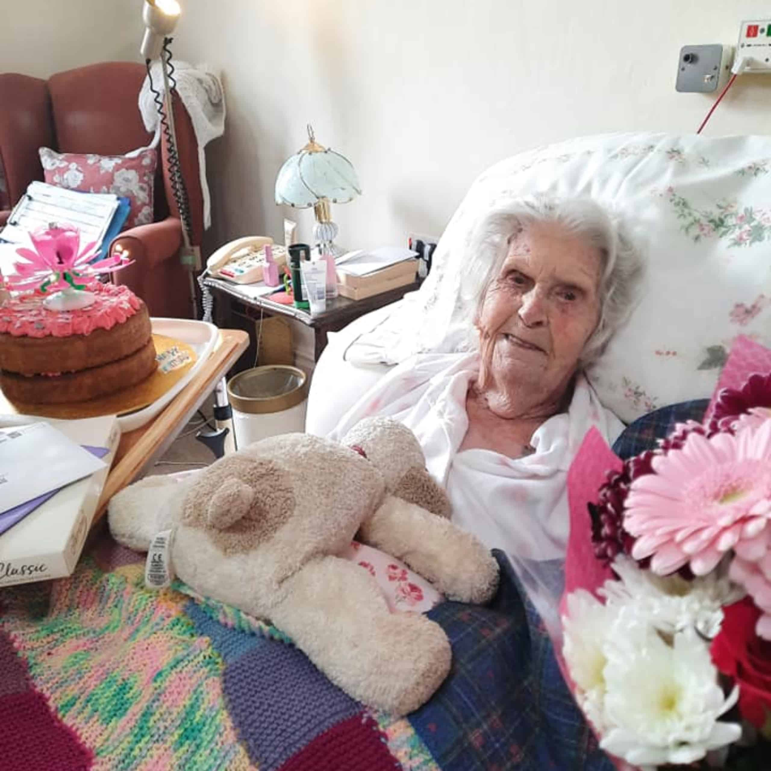 Wren House Care Home resident Barbara Elliot with her birthday cake and flowers.