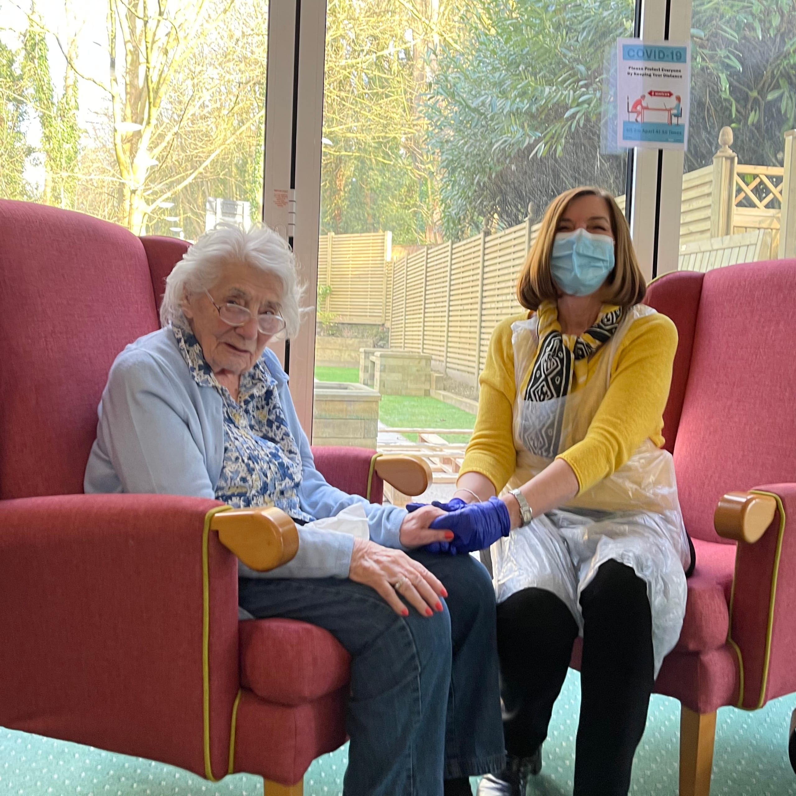 Westerham Place Care Home resident Joan welcomes her daughter in the designated visiting room for the first time.
