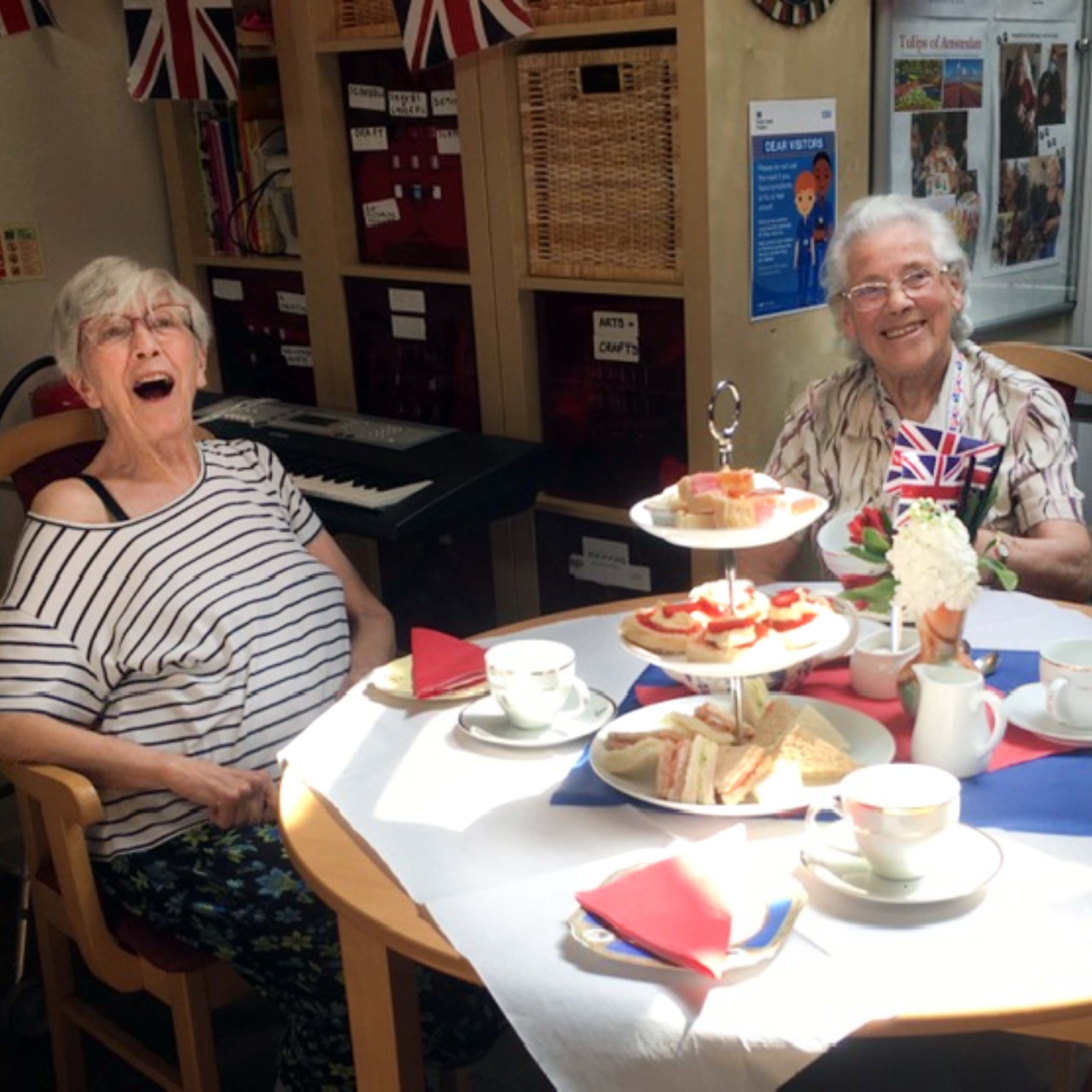 Linden House Care Home residents enjoying their 1940s themed afternoon tea.